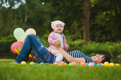 Happy mom and baby in the green park Stock Photos