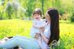 Happy mom and baby in the park in the summer Stock Photography