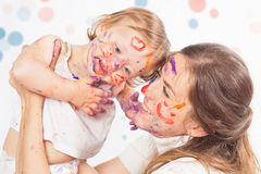 Happy mom and baby playing with painted face by paint Stock Photography