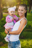 Happy mom and baby in the summer park Royalty Free Stock Photography
