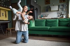 Happy mom or babysitter playing with kid girl at home royalty free stock image