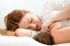 Happy mom breastfeeding newborn baby Royalty Free Stock Photos