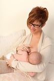 Happy mom breastfeeding Royalty Free Stock Photo