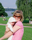 Happy mom with child. In the summer day Royalty Free Stock Photography