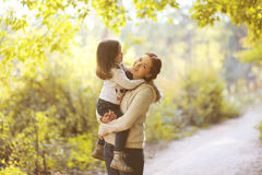 Happy mom and child in autumn. Park Royalty Free Stock Photography