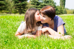 Happy mom and child girl hugging. The concept of childhood and family. Beautiful Mother and her baby outdoor Stock Image