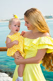 Happy mom and child girl hugging. The concept of childhood and family. Beautiful Mother and her baby outdoor Royalty Free Stock Photos