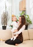 Happy mom and child girl hugging and laughing at home Royalty Free Stock Image
