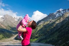 Happy mom and child girl hugging on nature The concept of childhood and family Stock Images