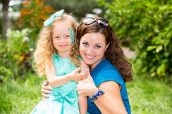 Happy mom and child girl hugging in outdoor. The concept of childhood and family. Portrait parent mother and kid. Positive human e. Motions feelings joy stock photography