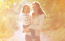 Happy mom and child outdoors in autumn Stock Photo