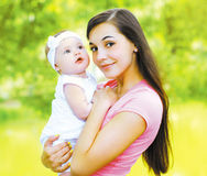 Happy mom and child in the summer sunny day Royalty Free Stock Images