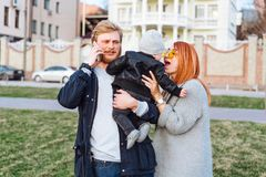 Happy mom dad and son hugging in the park. On a sunny day royalty free stock image
