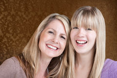 Happy Mom and Daughter. Happy Caucasian mom and daughter smile over green background Stock Images