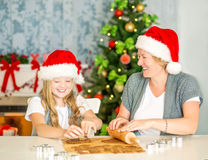 Happy mom and daughter baking Christmas cookies Royalty Free Stock Image