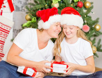 Happy mom and daughter with Christmas gifts Stock Photos