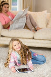 Happy mom and daughter lying on the floor Stock Photography