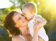 Happy mom and daughter smiling. At nature royalty free stock photos