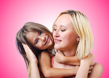 Happy mom and daughter on white Royalty Free Stock Photography