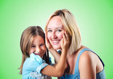 Happy mom and daughter on white Stock Photo