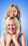 Happy mom and daughter on white Royalty Free Stock Photo