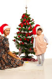 Happy mom and daughter with Xmas tree Stock Photos