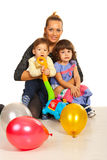 Happy mom embracing her kids. Happy mother embracing her kids  against white background Stock Photos