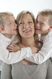 Happy Mom gets hugs and kisses for Mothers Day Royalty Free Stock Images