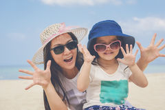 Happy mom and girl on the beach. Stock Photo