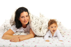 Happy mom and her baby in bed Stock Photography