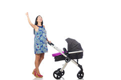 Happy mom with her baby in pram Stock Photos