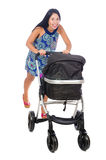 The happy mom with her baby in pram Stock Photo