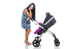 The happy mom with her baby in pram Royalty Free Stock Photos