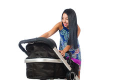The happy mom with her baby in pram Royalty Free Stock Images