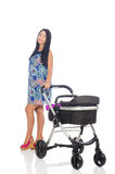 The happy mom with her baby in pram Stock Photos