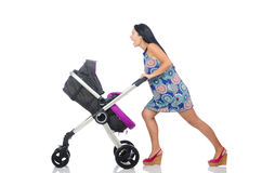 The happy mom with her baby in pram Stock Photography