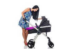 Happy mom with her baby in pram Stock Image