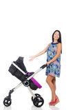 Happy mom with her baby in pram Royalty Free Stock Photos