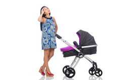 The happy mom with her baby in pram Royalty Free Stock Image