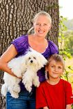 Happy Mom with her Child and a Pet Dog Stock Photography