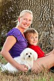 Happy Mom with her Child and a Pet Dog Royalty Free Stock Images