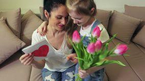 Happy mom with her daughter on mother`s day stock footage
