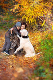 Happy mom and her son with dog Stock Photos