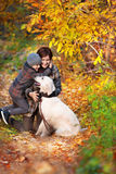 Happy mom and her son with dog Stock Image