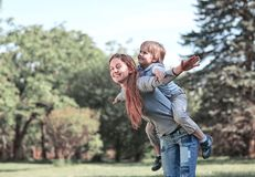 Happy mom and her son on a walk in the summer Park. The concept of happiness royalty free stock images
