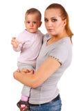 Happy mom hold sad girl Stock Photos