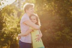 Happy mom hugs daughter teen stock photo