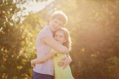 Happy mom hugs daughter teen outdoors stock image