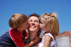 Happy mom and kids royalty free stock photos