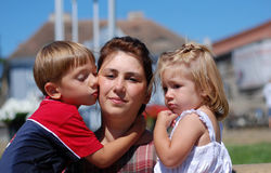 Happy mom and kids stock photography
